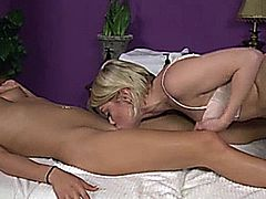 Blonde massage babe eats out client on her massage table