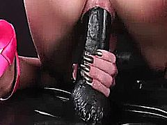 Hot amateur bitch with big silicone tits takes a huge fisting by her boyfriend and fucks a giant black dildo