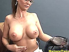 Mature cougar with spex gets a mouthful of cum after tugging cock
