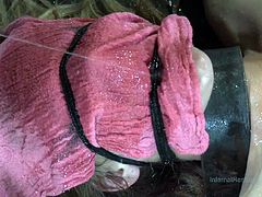 Innocent slave Mona is tied to the floor with a pink rag over her face so she can't see what is going to be done to her. The master canes her body and then uses a vibrators on her cunt. The combination of pain and pleasure is appealing to her.