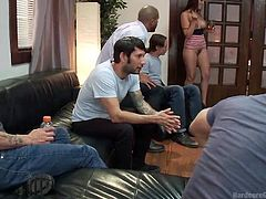 Tori is a good host. The busty babe offers a warm welcome to her male guests. They are all mesmerized by her lovely big tits inviting you to squeeze and suck them. The boys unzipped their pants. In the middle of the circle, the slutty tattooed bitch takes turns in sucking every single cock!