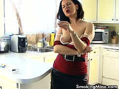 Mina smokes and shows her tits. This teaser surely has smooth pussy ready for anything  to satisfy us in every way. Horny brunette smoking and exposing her tits.
