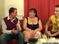 This fat mature feels so honored that a young guy wants to film her taking cock that she has a threesome with him and his friend. She gets stuffed from both ends.