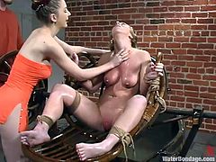This dirty slave is tied up and has her nose plugged. She is about to endure some humiliating water torture. The cruel mistress sprays the tied up slave's pussy with cold water. The pressure from the hose is both pleasurable and painful.