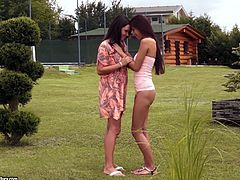 Charming babe with long hair in thong gets her natural tits sucked before enjoying her shaved pussy being licked and fingered outdoor
