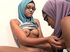 two very hot arab girls in a very erotic lesbian clip with a strap-on (french).