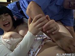 Ai Uehara was too excited to two Asian studs to join her for an MMF fuck session. She gets ready on the couch with her pussy.