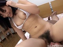 Marvelous Asian chick with natural tits in bikini unpins her attire before enjoying her hairy pussy being licked immensely
