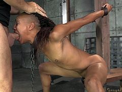 This ebony slave is tied up and face fucked by her master. He shoves his black cock deep into her throat. Her hand are tied behind her back and she has a fuck machine shoved way down into her pussy hole and she is tied up and restrained.