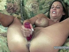 Leeanna Heart is a busty milf. She grabs a pink dildo, sucks on it and then she uses it to rub her clit and to fuck her mature cunt. She spreads wide for it.