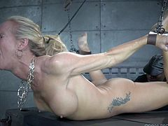 These scenes of real time bondage will definitely blow your mind! A blonde milf has been severely tied up with no possible chance to escape. While her horny cunt is aroused with using a vibrator, the slutty Simone is determined to suck a cock. Click to see!