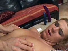 Blond milfs Sammie and Natasha Skinski, wearing panties and bras, pet each other indoors. Then they stuff each other's twats with vibrators and can't help but moan loudly.