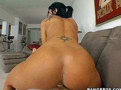 Stunning tattooed brunette with long hair in a sexy thong gives a superb blowjob then yells as her shaved pussy is throbbed doggystyle