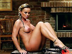 Silvia Saint fills the hole between her legs with toy for the camera in solo scene