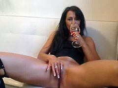 It is incredible what this milf shoves in her pussy. It must be really flexible or loose if it can take a huge gym toy inside it and a wine bottle. She is really enjoying herself.