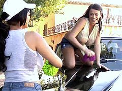 Gorgeous brunette lesbians with long hair in sexy shorts washing a car then smears themselves in soap then caress their big tits as they moan