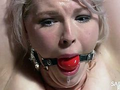 gagged, bound and hung from the ceiling
