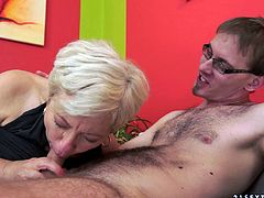 Gorgeous granny with with small tits give a huge python blowjob then moans while her tight pussy is being feasted hardcore doggystyle