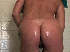 Marvelous tattooed cougar with natural tits in panties unpins her attire before taking shower while displaying her juicy tight pussy