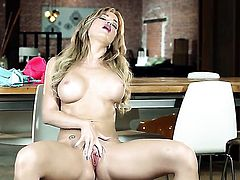 Angela Sommers with huge tits and trimmed cunt enjoys another solo sex session after stripping