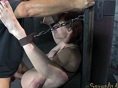 Are you fond of kinky scenes of creative rope bondage? Click to see a slutty brown-haired milf with big tits restrained. Her arms and legs are tied up with shackles and chains from an improvised chair. Enjoy watching Veronica while banged out hard with her legs widely opened.