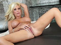 Tasha Reign has some time to stroke her cunt