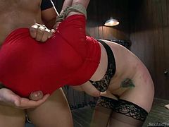 Redheaded Slave Katie is tied up by her cruel and dominating master. He pulls her shirt over head head so that she cannot see as her fucks her hard. She get rammed from behind, and he slaps his cock against the cloth covering her face. She has to stay in the dungeon and be his submissive slut.
