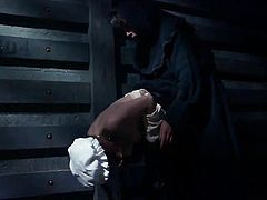 Back in the 1800s it seems everyone was a creep. This couple watches a weird ritual with a woman in prison. She slave gets clamps put on her nipples and has her tits pulled by the cloaked master. How much can she take?