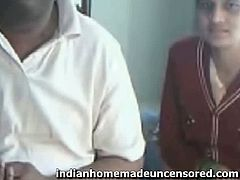 It looks like this Indian couple has their webcam on. At some point, she unbuttons her shirt and shows off her tits. Then, she dresses back on. They are exhibitionists.