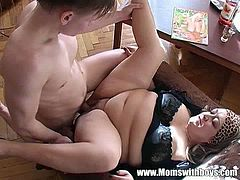 These naughty mature mom and this young male teen are unusual fuck buddies and together they are having a rough fucking session in the cougar's house alone.