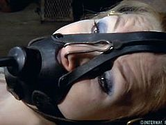 Sexy Blond Endures Foot Torture and Orgasms while Bound in a Metal Chair