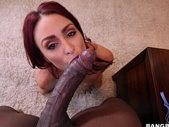 This hot redhead is there when her black boyfriend approaches wearing a towel. She lets him drop the towel to reveal his massive black cock. She slobbers all over his cock and tries to get as much of his black rod inside her throat as she can.