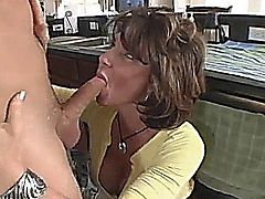 Deauxma fucks the plumber in the kitchen