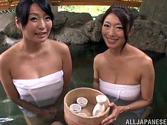 Busty Japanese cougars with long hair and impressive natural tits getting frisky before giving wild blowjob in ffm threesome