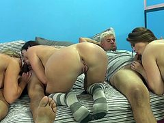 Tattooed cowgirl with big tits showcase her ass while giving her guy blowjob before working on her pussy using toy and getting fucked in group sex