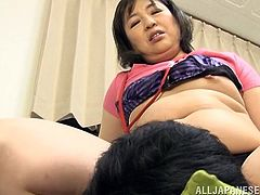 This guy gets a taste of mature Asian nipples and the hefty lady sits on his face and makes him eat out her hairy cunt. The chubby girl climbs on top of his cock and ride him while pinching his nipples.