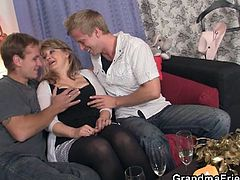 Two horny fellows pick up a mature lady who later sucks them both and lets them fuck her hard.