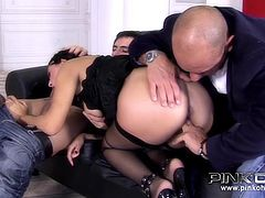 A horny brunette girl with curly hair dressed up in sexy lingerie and wearing an evening subtle makeup gets in a dirty game in the presence of two guys.