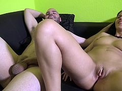 Beautiful brunette with a shaved pussy enjoying a hardcore fuck on her sofa