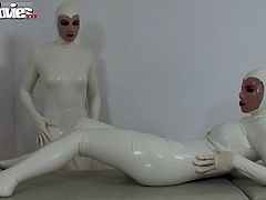 Two lovely sluts are touching themselves after dressing up in white latex costumes..