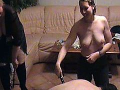 A French domina invites a couple and explain how to dominate the husband.  He will be forced to be fucked, and suck another man