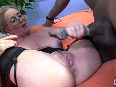 Blond mature whore in glasses Jenna Covell performs divine oral skills to black guys