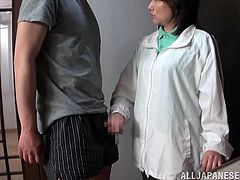 This fully clothed mature Japanese lady grabs her man's cock in the middle of the night. She tugs him off and before long she is on her knees sucking on his cock. He takes her jacket off and rubs on her boobs.