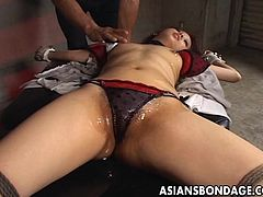 If you are into Asian bitches and bondage hardcore scenes, don't hesitate to click. A helpless naughty bitch lays on the floor, while her clothes are torn and cut with a scissors. You can see her small tits and slim body covered with oil. Watch her obeying!