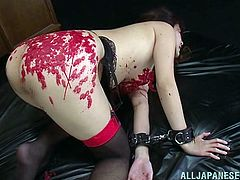 Have you ever seen a Japanese slut, that loves as much pain, as this? She is tied down by her masters and fingered, before they pour hot wax all over her body, including on her tits and thighs. Now she is ready to give them both blowjobs.