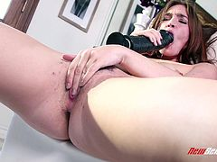 Stimulating solo model with a nice ass yelling as she smashes her hairy pussy with a huge vibrator