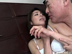 This old weirdo rips off his wife's clothes and licks her body all over. He sucks on her fingers and kisses her hard, before sliding his hand down to her panties, and rubbing on her hairy cunt. He is quite a perv and loves to lick her thighs.