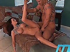 A beautiful hot mature brunette takes great care of a large cock in each of her very hot holes