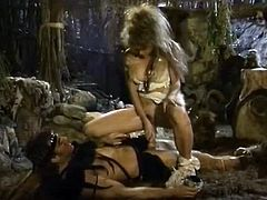 1980 is the year when this hot blonde was fucked by a barbarian in a cave. She had a hairy cunt and she was obeying to her man. He came on her ass and went to sleep.