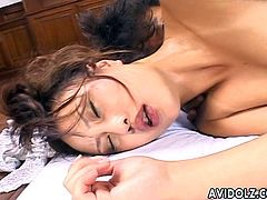 Tantalizing Japanese cutie slurps her horny lover's big dong. She slides her tender hairy snatch down on his erect sausage and rides on it before being screwed hard.